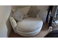 White leather love chair.