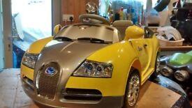 A new yellow Bugatti Veyron sports roadster 6 volts)