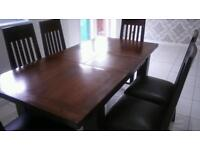 solid wood extendable dining suite and six chairs