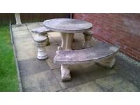 Solid round garden furniture in great condition,comes with 2 benches and 2 matching stools.