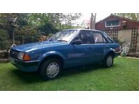 1984 Ford Escort , blue 4 door. 41,000 miles