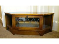 Solid Oak television stand with shelf and glass front ,in very good condition nice shape and colour.