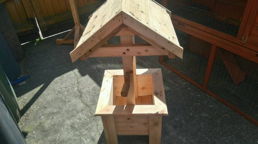 Wooden wishing well for garden or wedding