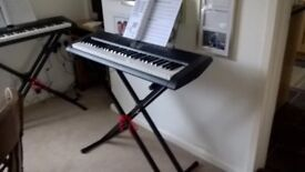 Casio keyboard with stand.
