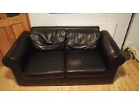 Genuine black leather 2 seater sofa £100 ONO