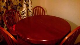Solid extendable table and chairs