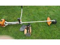 Stihl FS400 petrol strimmer with harness industrial tool.