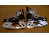 size 8.5 Nike Bauer ice skates.