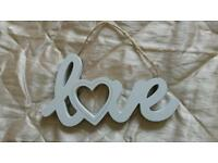 """Love"" hanging wall art."