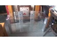 Glass TV table suitable for large TV and with shelves to hold DVD's etc