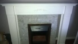 Fireplace with Marble back and hearth and fan convector fire