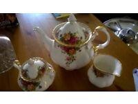 Tea pot with milk and sugar