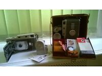 Polaroid 800 cameras for sale. 2 Vintage cameras with cases and several accessories.