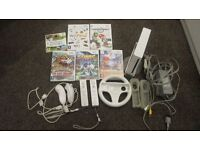 Unboxed: Nintendo Wii, 5 x Games, 2 x Remotes, 2 x Nunchuk's and 1 x Steering Wheel