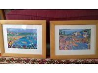 A pair of framed children's prints
