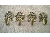 Antique brass ornate bow hooks / curtain tiebacks in good condition set of four Collect only