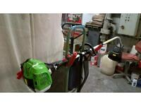 petrol grass strimer never been used new its a heavy duty one with harness to strap on