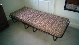 Folding Single Bed.