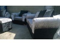 Sofas & armchair Brand Spanking New in black and silver Crushed Velvet, also pouffe, can deliver.