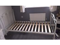 Single White metal bed frame with slats.