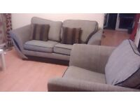 Can deliver modern 2 seater sofa bed and matching chair very good condition