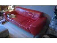 Red leather sofa - Can deliver locally