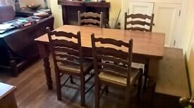 Pine table, 4 pine & wicker chairs & small pine bench