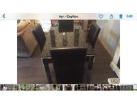 Black glass n Crome dining table 4 chairs also tv unit to match