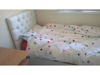 Single bed with headboard, mattress, feather duvet, pillow and covers
