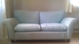 Pretty, pale Turquoise, two-seat Sofa. Very comfortable with removable cushion covers.