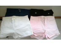 FOUR PAIRS OF VERY GOOD SHORTS IN VARIOUS COLOURS SIZE 6