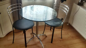 Black marble and chrome dining table with 2 chairs, in excellent condition,
