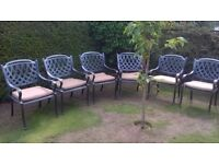 Set of 6 quality metal garden chairs complete with cushions.