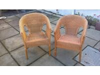 two wicker arm chairs for sale