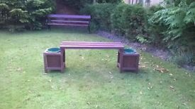 Pair of planters incorprorating a garden bench.