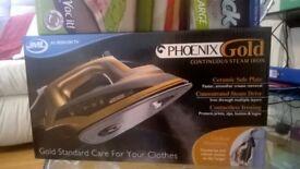 brand new pheonix gold steam iron