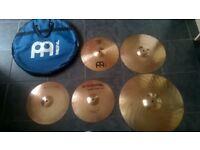 Set of cymbals including bag.