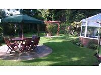 Teak garden table, 6 folding chairs and umbrella