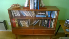 Two solid wood glass fronted bookcases