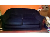 SOFA BLUE WITH SMALL WHITE DOTS FLIPS OUT TO CONVERT TO A BED