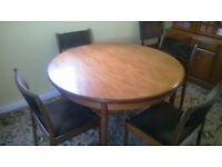 Teak dining table - circular 4 seater - extends to 6 seater oval - PRICED TO SELL