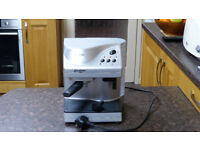 Kenwood expresso coffee machine with milk frother and instructions.