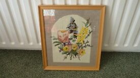 Framed embroidery panel