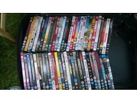 Assorted DVDs for sale, approximately 70 in one case.