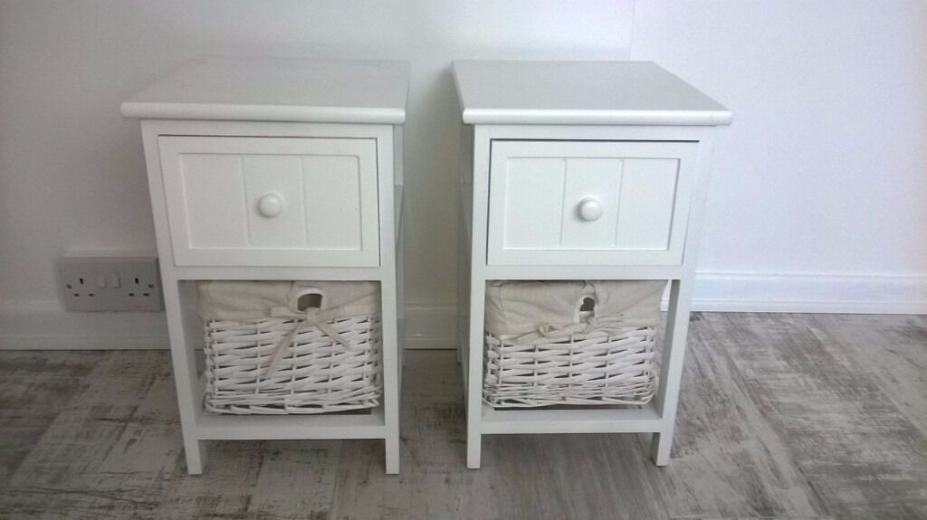 Bedside Tablesin Little Stoke, BristolGumtree - A pair of small bedside tables / cabinets with baskets. Perfect for a spare room. 46cm H x 28cm W x 30 cm D. Collection from Little stoke area