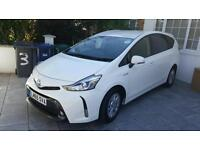 A VERY BEAUTIFUL TOYOTA PRUIS PLUS 7 SEATER IN WHITE COLOUR WITH FULLY BLACK LEATHER FOR SALE