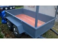 Twin axle metal trailer, 8x4 Strong builders type trailer. New Floor and painted. Spare wheel