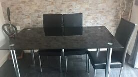 Large black glass table