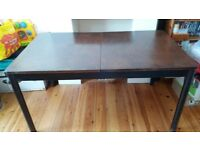 Extendable solid wood dining table (6 to 8 seats)