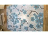 beautiful large rug in cream, beige and duck egg blue